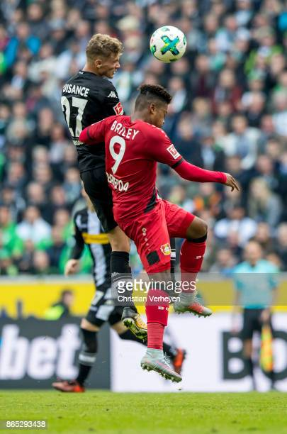 Michael Cuisance of Borussia Moenchengladbach and Leon Bailey of Bayer 04 Leverkusen battle for the ball during the Bundesliga match between Borussia...
