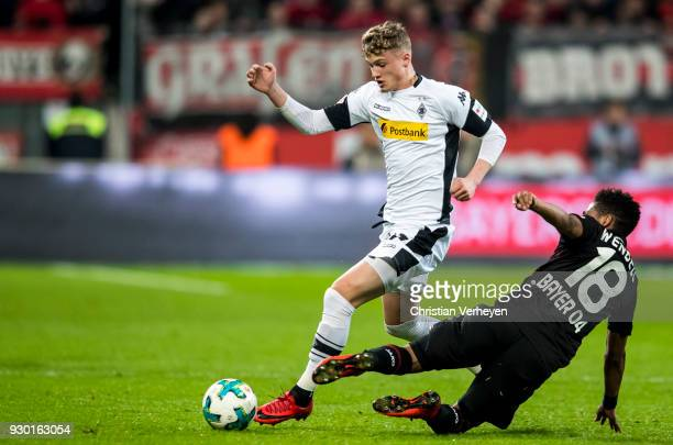 Michael Cuisance of Borussia Moenchengladbach and Wendell of Bayer 04 Leverkusen battle for the ball during the Bundesliga match between Bayer 04...
