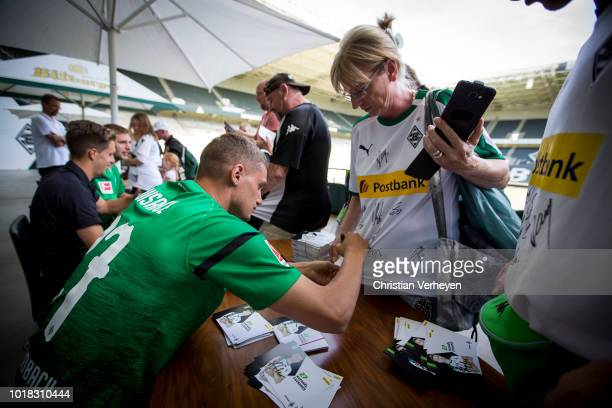 Michael Cuisance of Borussia Moenchengladbach sign for the supporters at the Season Opening Party after the preseason friendly match between Borussia...