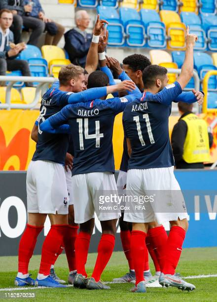 Michael Cuisance of France celebrates with teammates after scoring his team's first goal during the 2019 FIFA U-20 World Cup group E match between...