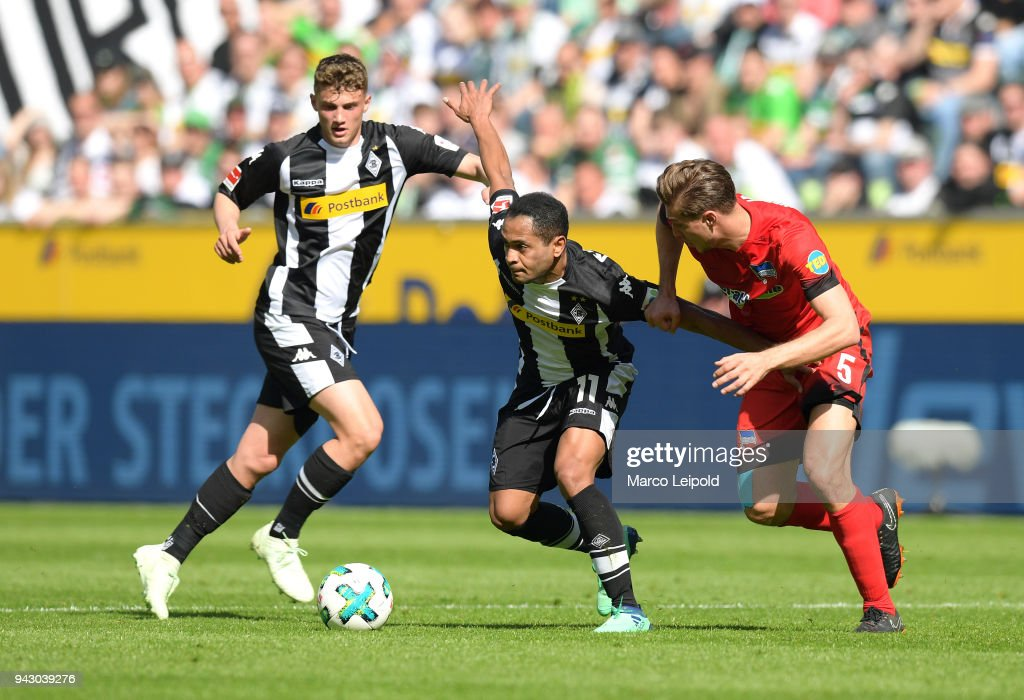 Michael Cuisance, Raffael of Borussia Moenchengladbach and Niklas Stark of Hertha BSC during the Bundesliga game between Borussia Moenchengladbach and Hertha BSC at Borussia Park Stadion on April 7, 2018 in Moenchengladbach, Germany.