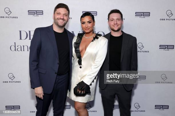 Michael D. Ratner, Director/Executive Producer OBB Pictures, Demi Lovato and Scott Ratner attend the OBB Premiere Event for YouTube Originals...