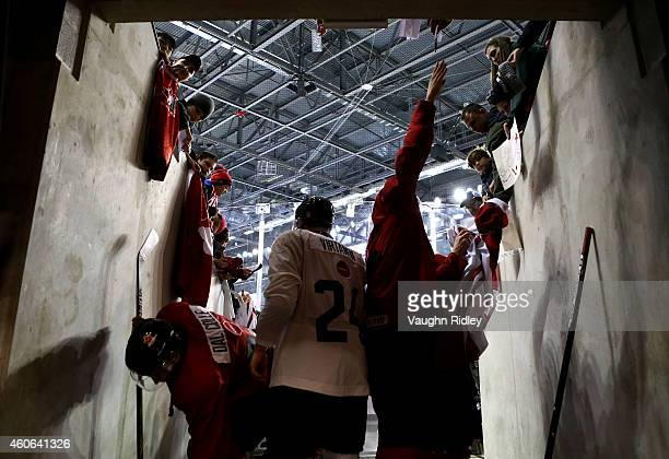 Michael Dal Colle Jake Virtanen and Nick Ritchie sign autographs following the Canada National Junior Team practice at the Meridian Centre on...
