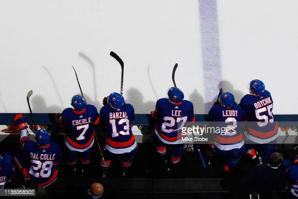 Michael Dal Colle Jordan Eberle Mathew Barzal Anders Lee Nick Leddy and Johnny Boychuk of the New York Islanders look on from the bench against the...