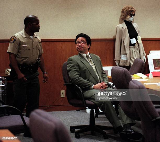 Michael Dally looks at bailiff during a break in closing arguments Wednesday in Ventura. Dally is on trial for his alleged role in the murder of his...