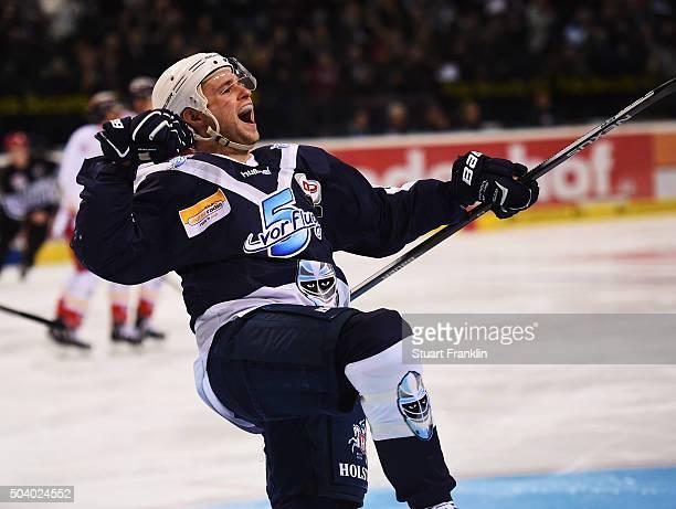 Michael Davies of Hamburg celebrates scoring the second goal during the DEL ice hockey match bewteen Hamburg Freezers and Duesseldorfer EG at...