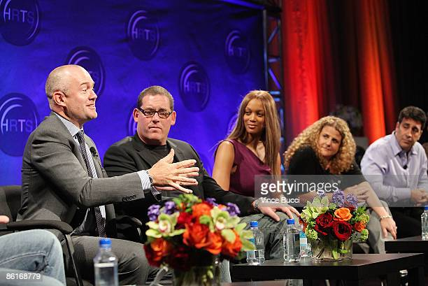 Michael Davies president Embassy Row speaks to producers Mike Fleiss Tyra Banks Allison Grodner and Arthur Smith at The Hollywood Radio and...