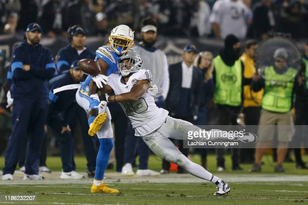 Michael Davis of the Los Angeles Chargers breaks up a pass intended for Tyrell Williams of the Oakland Raiders in the third quarter at RingCentral...