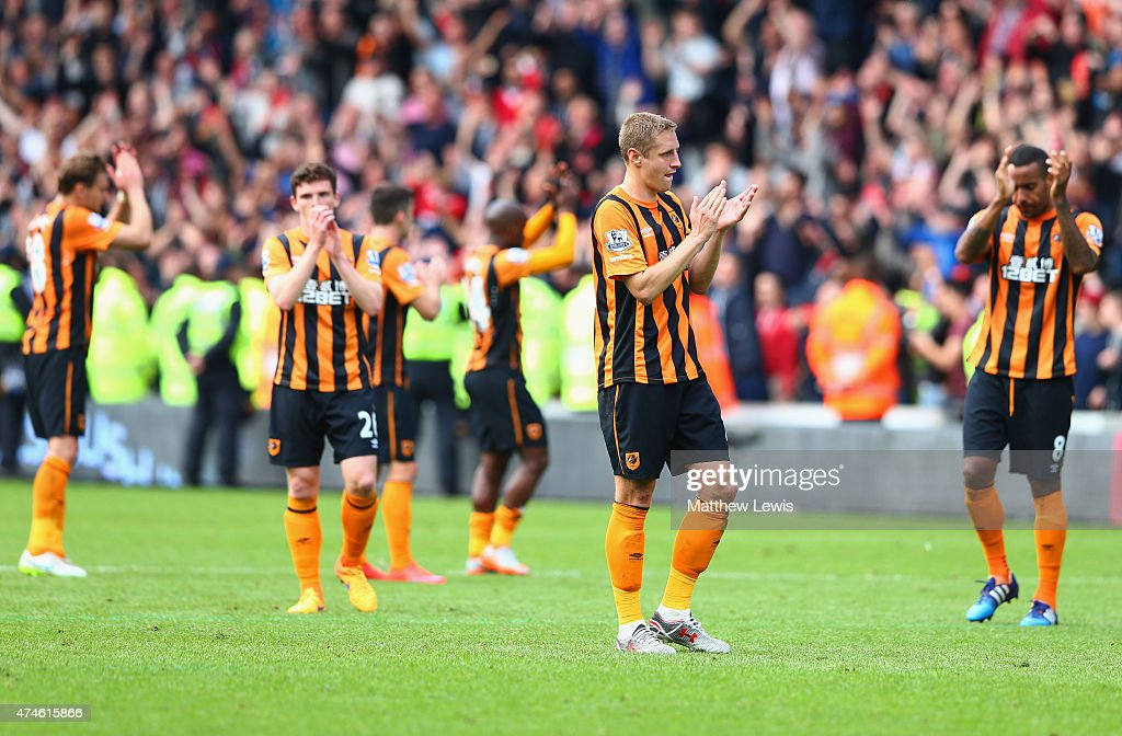Michael Dawson (2nd R) and Hull City players applaud supporters after relegated from the Premier League during the Barclays Premier League match between Hull City and Manchester United at KC Stadium on May 24, 2015 in Hull, England.