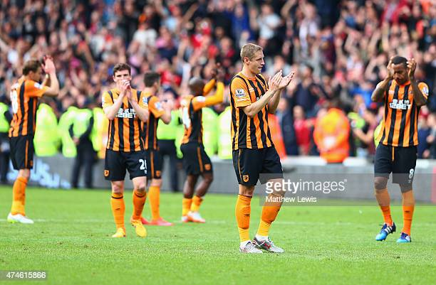 Michael Dawson and Hull City players applaud supporters after relegated from the Premier League during the Barclays Premier League match between Hull...