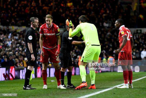 Michael Dawson Costel Pantilimon and Tendayi Darikwa of Nottingham appeal for handball to Referee Geoff Eltringham and assistant referee after they...