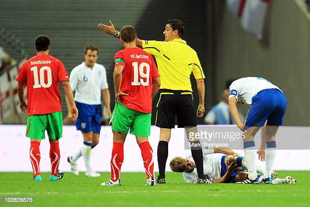 Michael Dawson of England goes down injured during the UEFA EURO 2012 Group G Qualifying match between England and Bulgaria at Wembley Stadium on...