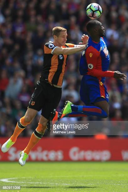 Michael Dawson of Hull City and Christian Benteke of Crystal Palace battle to win a header during the Premier League match between Crystal Palace and...