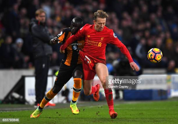 Michael Dawson of Hull City and Lucas Leiva of Liverpool battle for possession during the Premier League match between Hull City and Liverpool at...