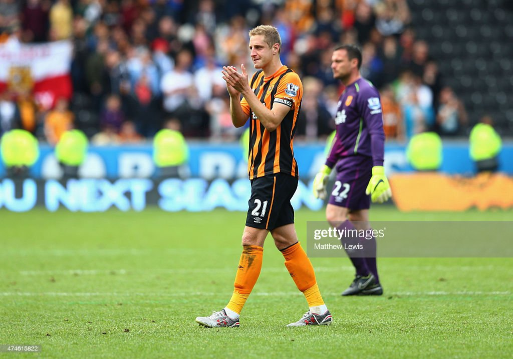 Michael Dawson of Hull City applauds supporters after relegated from the Premier League during the Barclays Premier League match between Hull City and Manchester United at KC Stadium on May 24, 2015 in Hull, England.