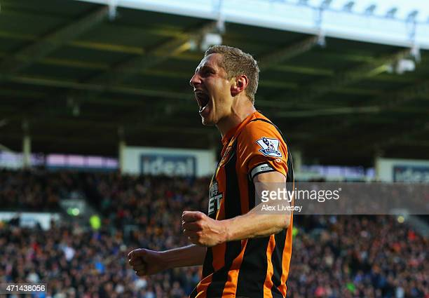 Michael Dawson of Hull City celebrates as he scores their first goal during the Barclays Premier League match between Hull City and Liverpool at KC...