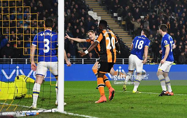 Michael Dawson of Hull City celebrates scoring the opening goal during the Premier League match between Hull City and Everton at KCOM Stadium on...