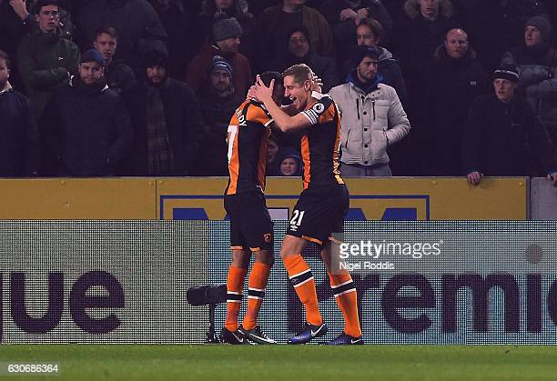 Michael Dawson of Hull City celebrates scoring the opening goal with Ahmed Elmohamady of Hull City during the Premier League match between Hull City...