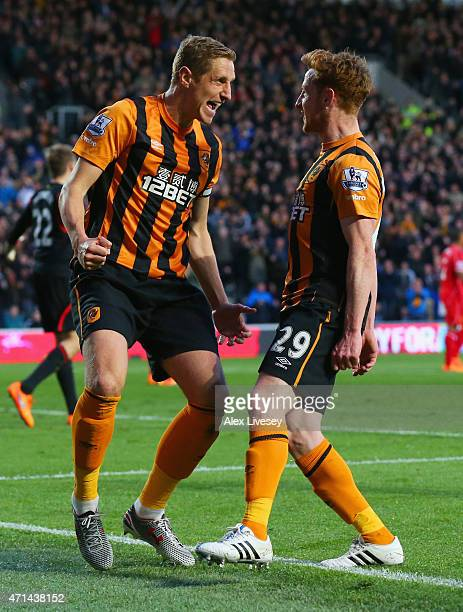 Michael Dawson of Hull City celebrates with Stephen Quinn as he scores their first goal during the Barclays Premier League match between Hull City...