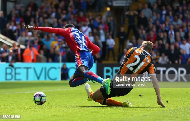 Michael Dawson of Hull City fouls Jeffrey Schlupp of Crystal Palace leading to a penalty which is scored to make it 30 during the Premier League...