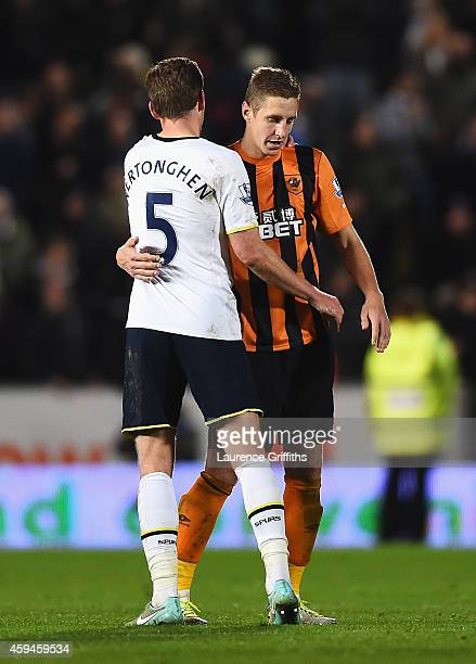 Michael Dawson of Hull City is consoled by Jan Vertonghen of Tottenham Hotspur after the Barclays Premier League match between Hull City and...
