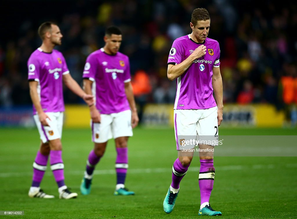 Michael Dawson of Hull City (R) is defected after the final whistle during the Premier League match between Watford and Hull City at Vicarage Road on October 29, 2016 in Watford, England.
