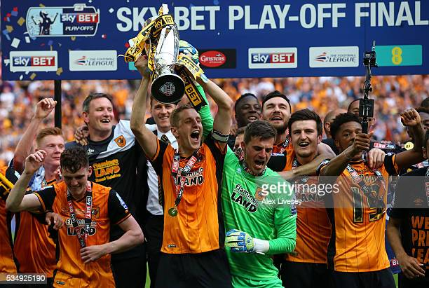 Michael Dawson of Hull City lifts the trophy after victory in the Sky Bet Championship Play Off Final match between Hull City and Sheffield Wednesday...