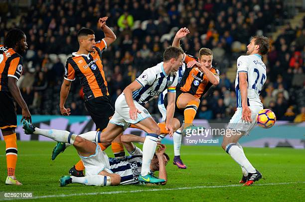 Michael Dawson of Hull City scores his team's first goal during the Premier League match between Hull City and West Bromwich Albion at KCOM Stadium...