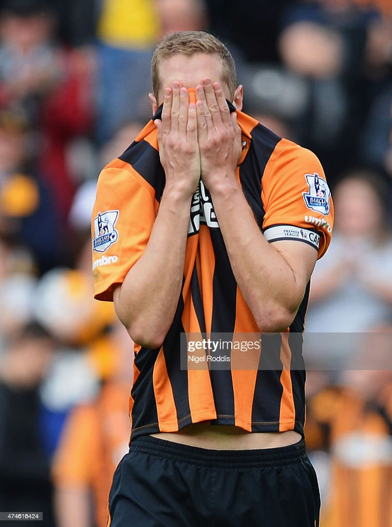 Michael Dawson of Hull City shows his dejection after being relegated from the Premier League during the Barclays Premier League match between Hull City and Manchester United at KC Stadium on May 24, 2015 in Hull, England.