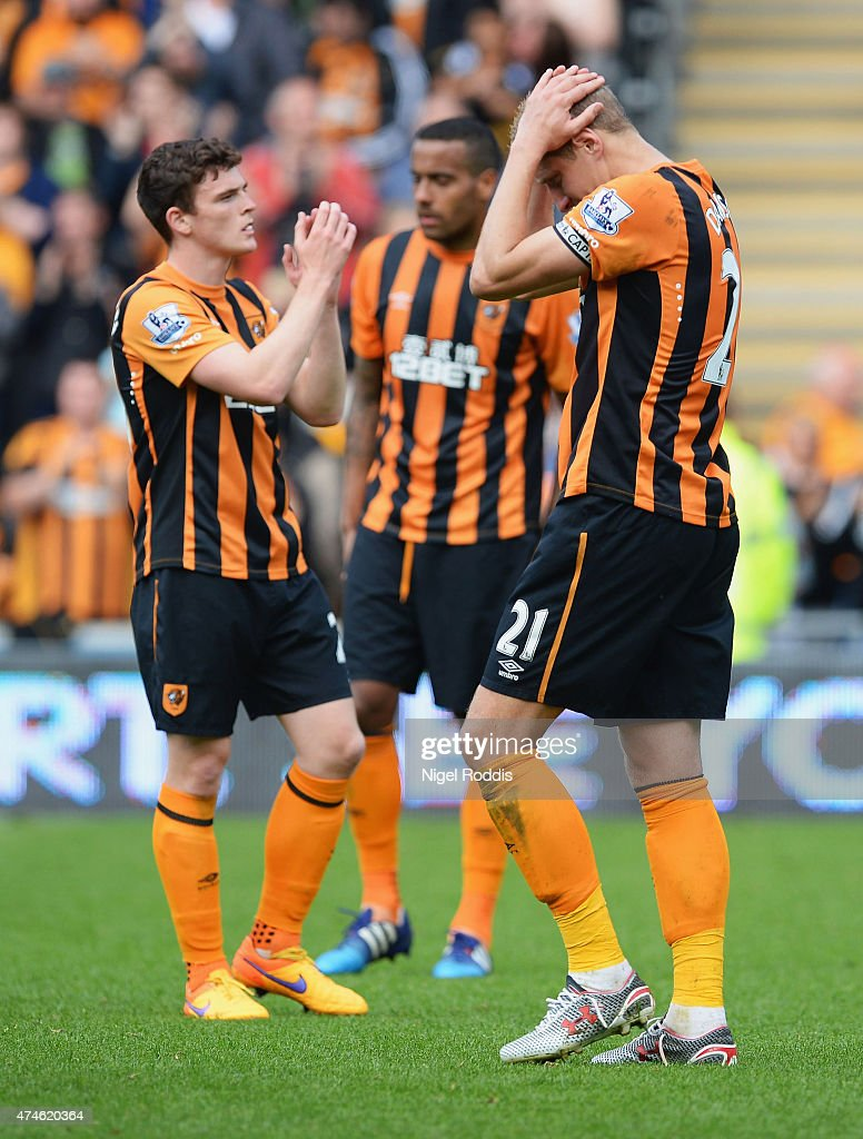 Michael Dawson (R) of Hull City shows his dejection after being relegated from the Premier League during the Barclays Premier League match between Hull City and Manchester United at KC Stadium on May 24, 2015 in Hull, England.