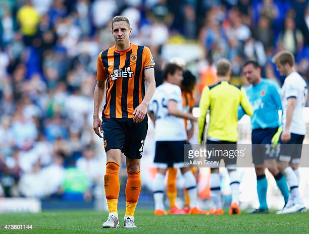 Michael Dawson of Hull City shows his dejection after his team's defeat in the Barclays Premier League match between Tottenham Hotspur and Hull City...