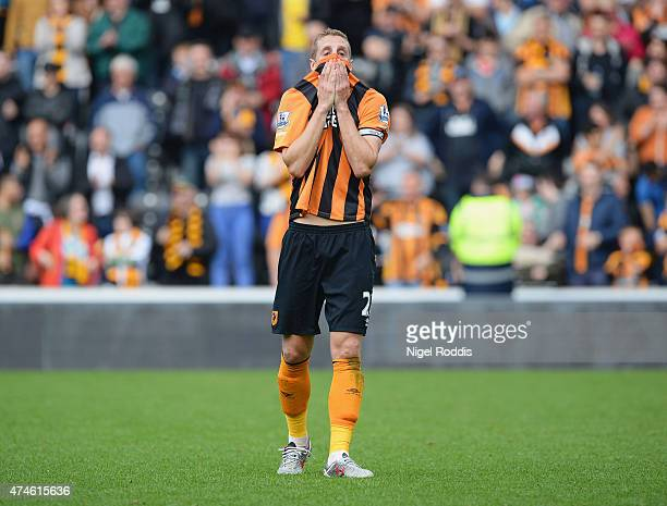Michael Dawson of Hull City shows his dejection after relegated from the Premier League during the Barclays Premier League match between Hull City...