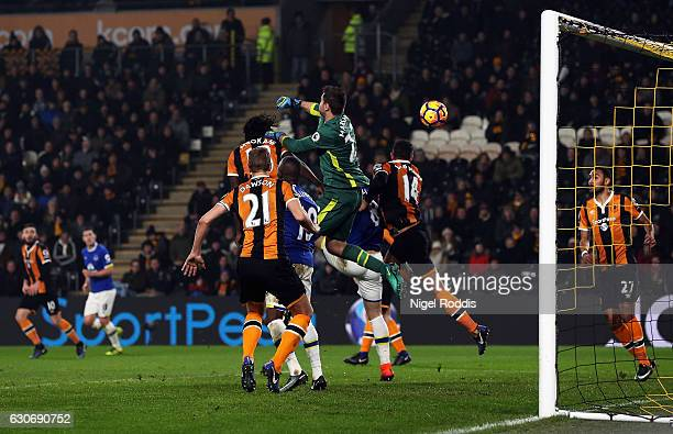 Michael Dawson of Hull City watches as goalkeeper David Marshall of Hull City scores an own goal during the Premier League match between Hull City...