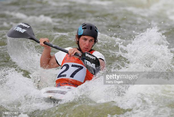 Michael Dawson of New Zealand competes in the Men's K1 event during the ICF Canoe Slalom World Cup at Cardiff International White Water on June 9...
