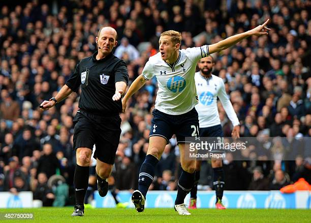 Michael Dawson of Tottenham Hotspur appeals to Referee Mike Dean as he awards Manchester United a penalty during the Barclays Premier League Match...