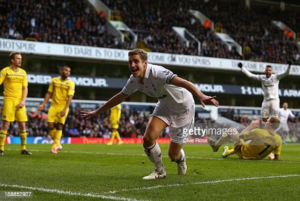 Michael Dawson of Tottenham Hotspur celebrates scoring their first goal during the Barclays Premier League match between Tottenham Hotspur and...