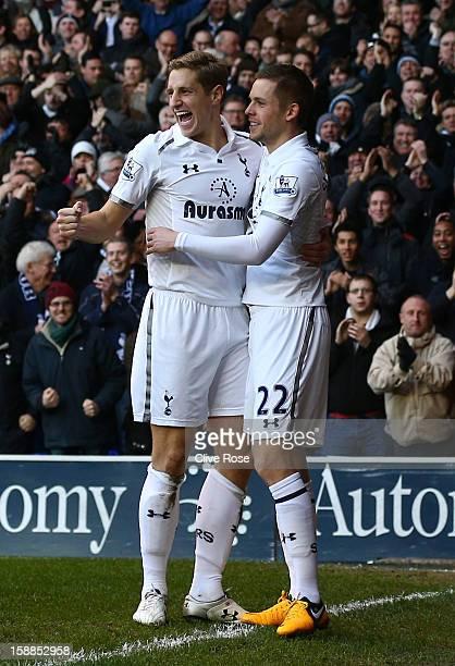 Michael Dawson of Tottenham Hotspur celebrates scoring their first goal with Gylfi Sigurdsson of Tottenham Hotspur during the Barclays Premier League...