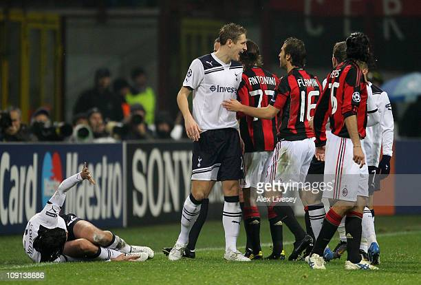 Michael Dawson of Tottenham Hotspur has words with Mathieu Flamini of AC Milan following his challenge on team mate Vedran Corluka during the UEFA...