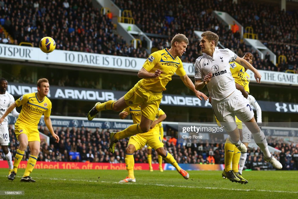 Michael Dawson of Tottenham Hotspur heads in their first goal during the Barclays Premier League match between Tottenham Hotspur and Reading at White Hart Lane on January 1, 2013 in London, England.