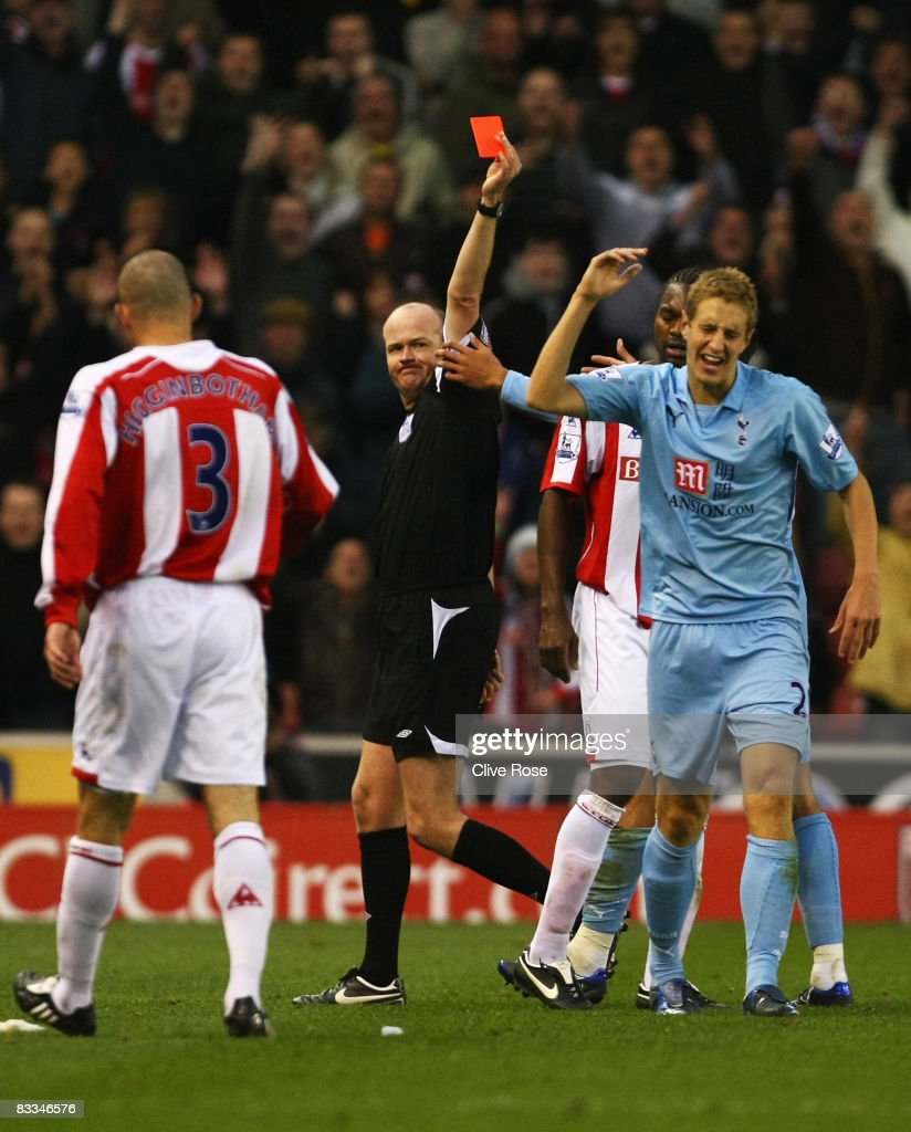 Michael Dawson of Tottenham Hotspur reacts after being shown the red card by referee Lee Mason during the Barclays Premier League match between Stoke City and Tottenham Hotspur at the Brittania Stadium on October 19, 2008 in Stoke, England.