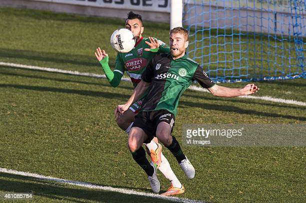 Michael de Leeuw of FC Groningen in duel with a player of Mouloudia Club d'Alger During the friendly match between FC Groningen and Mouloudia Club...