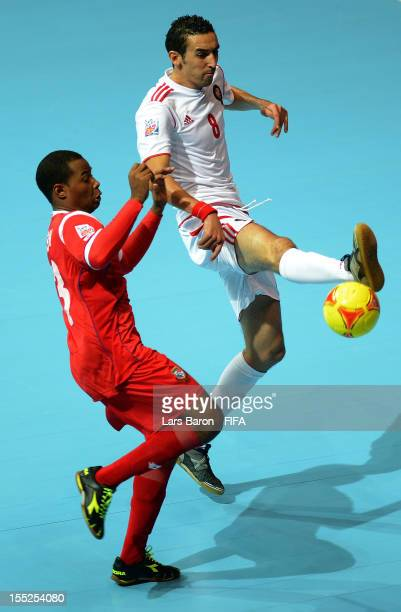 Michael de Leon of Panama challenges Adil Habil of Morocco for the ball during the FIFA Futsal World Cup Group B match between Panama and Morocco at...