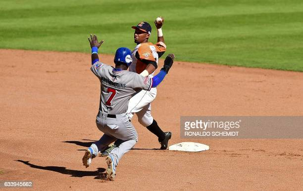 Michael de Leon of Tigres del Licey of the Dominican Republic tags out in second base during a Caribbean Baseball Series match gainst Aguilas del...