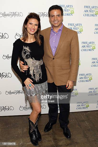 Michael De Luca and Angelique De Luca attend the 'Lauren Moshi Gallery for Free Arts for Abused Children' event at Lauren Moshi Gallery on December 6...