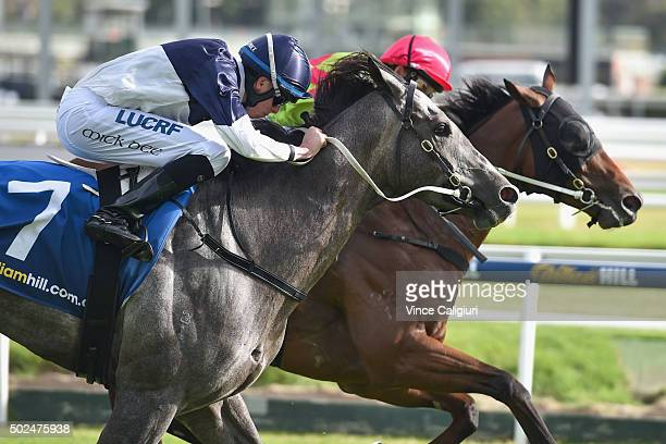 Michael Dee riding Volcanic Ash winning Race 10 during Melbourne Racing at Caulfield Racecourse on December 26 2015 in Melbourne Australia