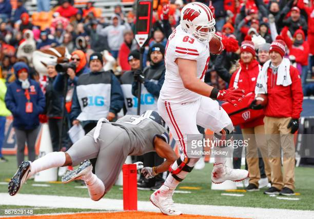 Michael Deiter of the Wisconsin Badgers scores a touchdown during the game as Del'Shawn Phillips of the Illinois Fighting Illini misses the tackle at...