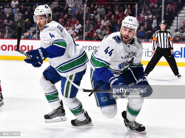 Michael Del Zotto and Erik Gudbranson of the Vancouver Canucks skate towards the action against the Montreal Canadiens during the NHL game at the...