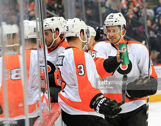 Michael Del Zotto and Radko Gudas of the Philadelphia Flyers discuss strategy during a third period stoppage in play against the Winnipeg Jets at the...