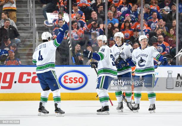 Michael Del Zotto Jussi Jokinen Adam Gaudette and Troy Stecher of the Vancouver Canucks celebrate after a goal during the game against the VEdmonton...