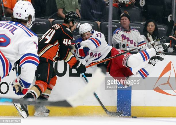 Michael Del Zotto of the Anaheim Ducks checks Jesper Fast of the New York Rangers during the first period at the Honda Center on December 14, 2019 in...